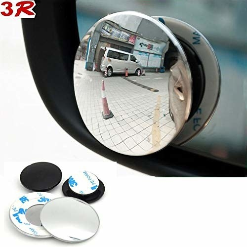 A blind spot mirror on a car mirror
