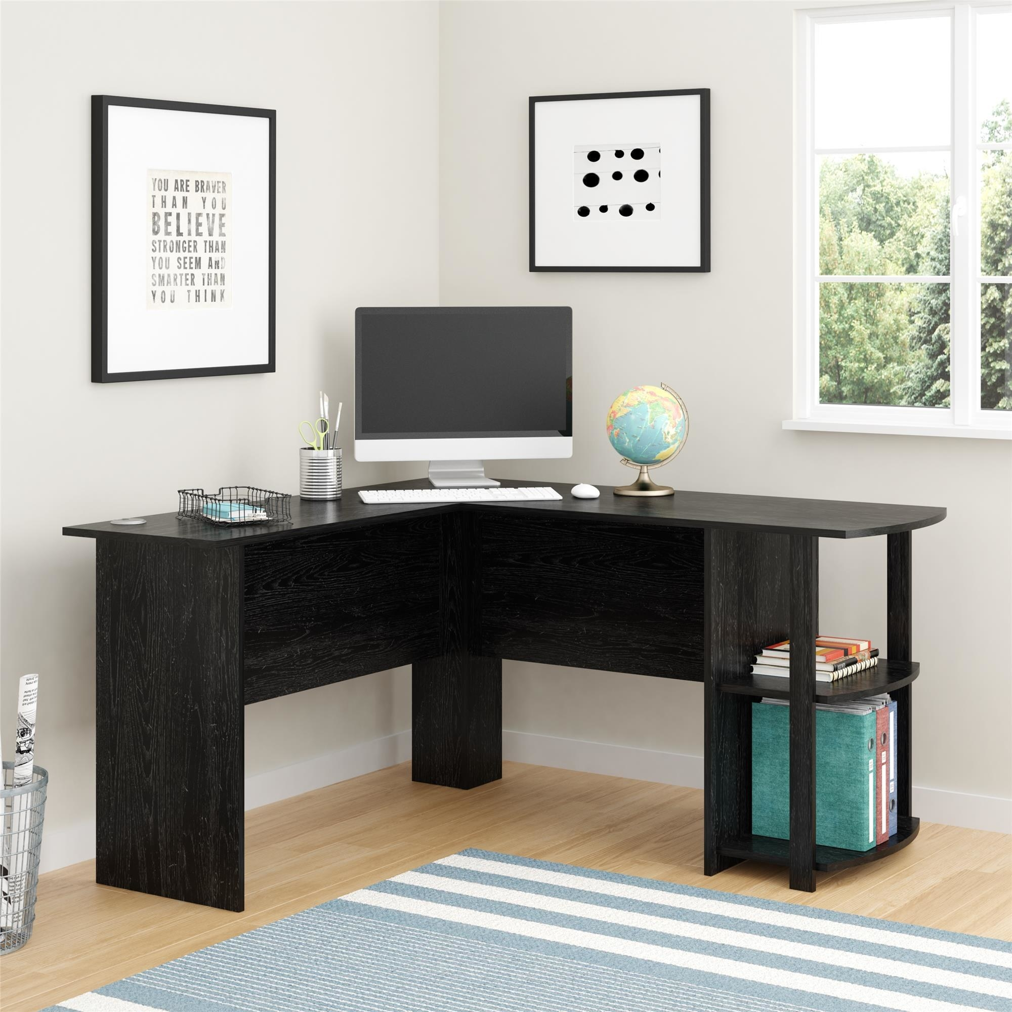 the desk in an office in the color black oak