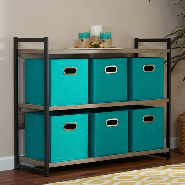 6 teal colored storage cubes on a two-shelf console