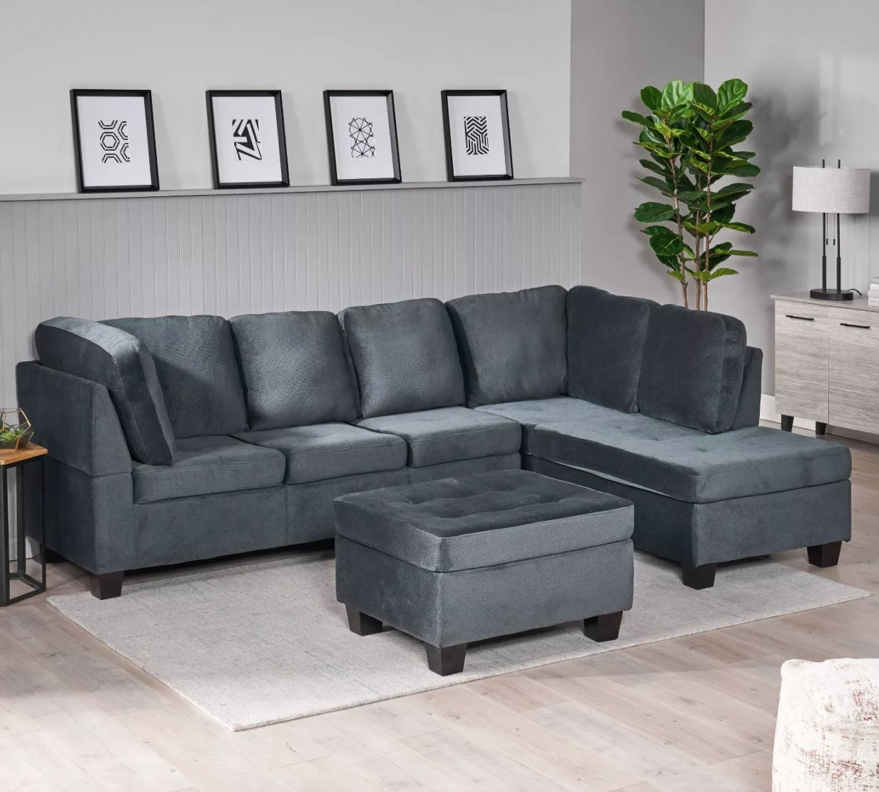 A gray sectional with chaise and ottoman with seats for six