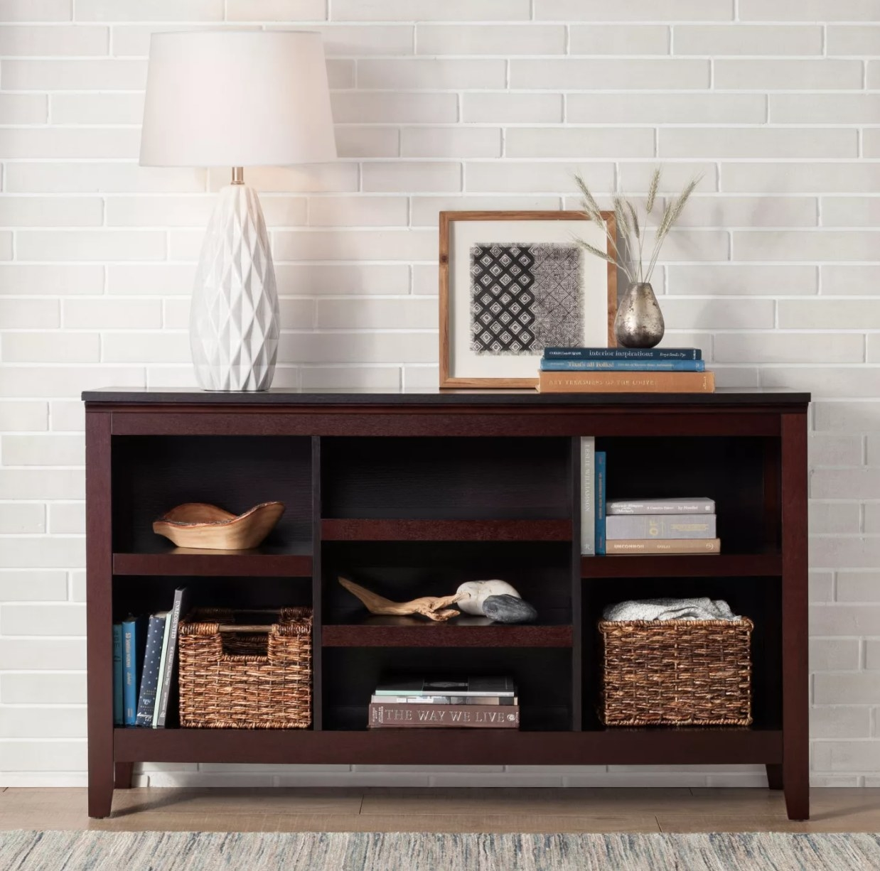 A brown wooden horizontal bookcase with four open shelves