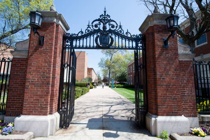 The gates of a college are part of brick pillars.