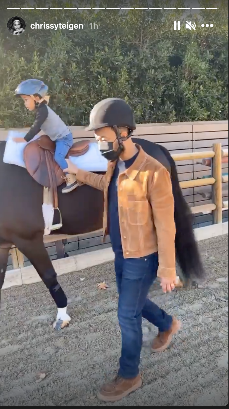 Miles rides the horse as John holds his ankle