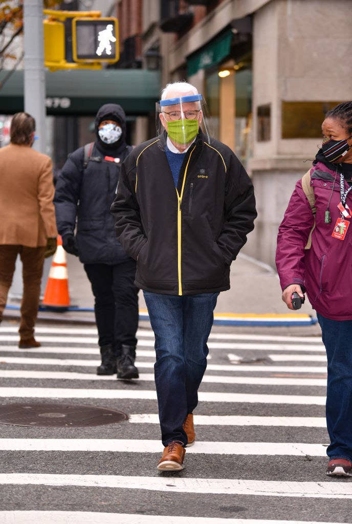 Steve walking on the street with a mask and face shield on
