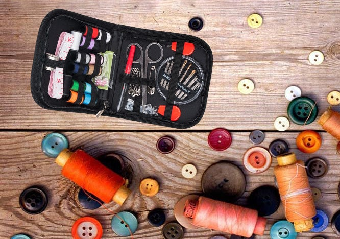 The sewing kit with needs, thread, scissors, and measuring tape