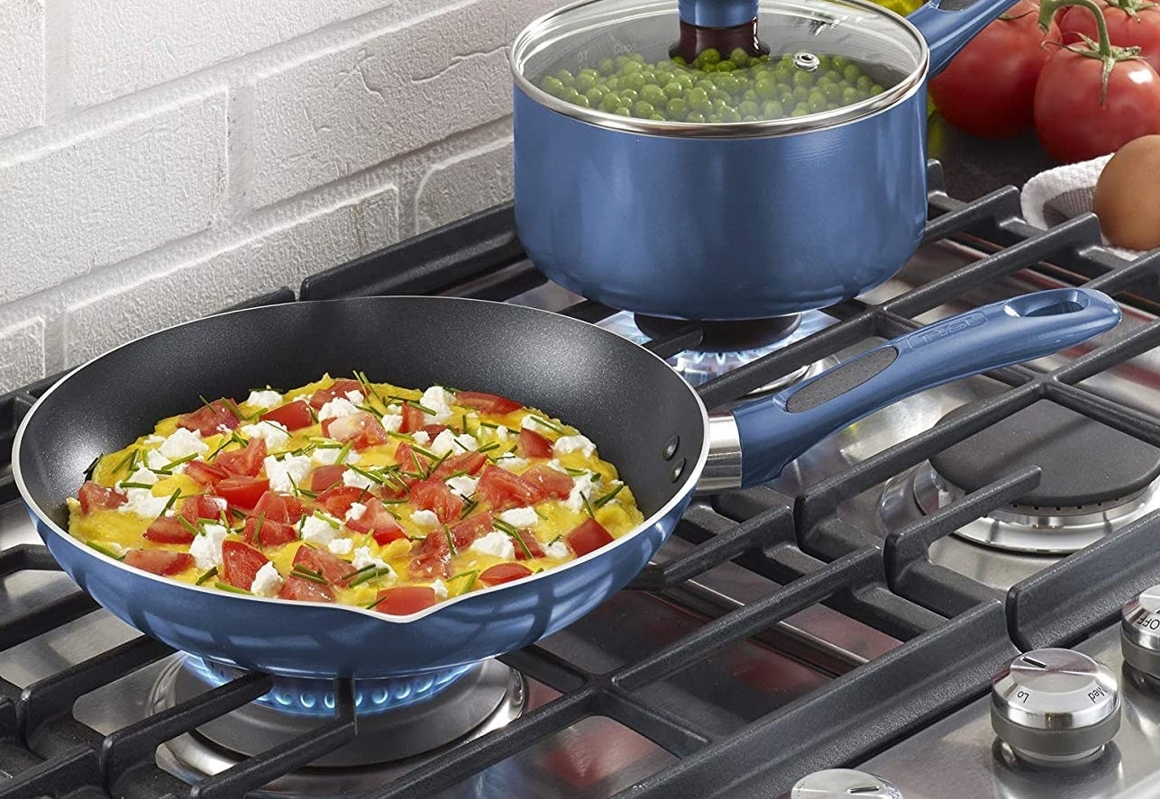 The pan with a tasty omelet cooking on a stove
