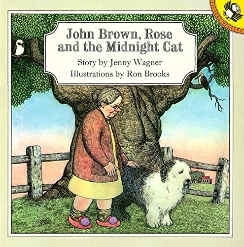 Book cover shows an old woman in slippers walking her shaggy dog next to a giant tree with a kookaburra sitting on a branch and a wooden fence