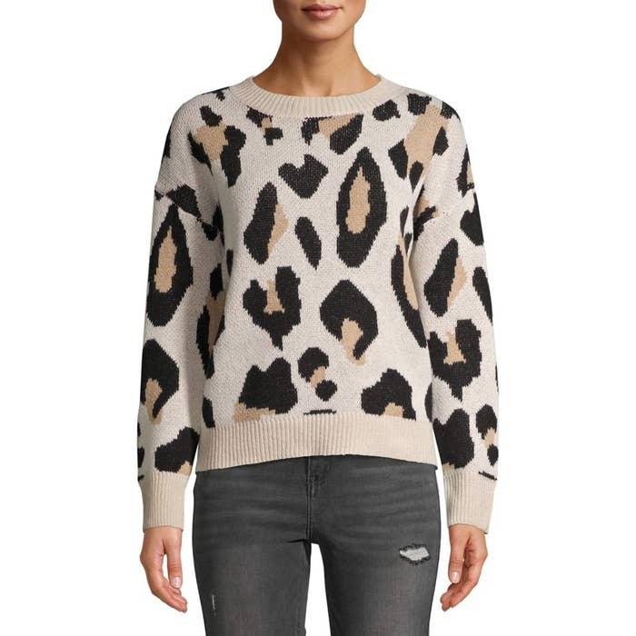 The tan leopard-print sweater