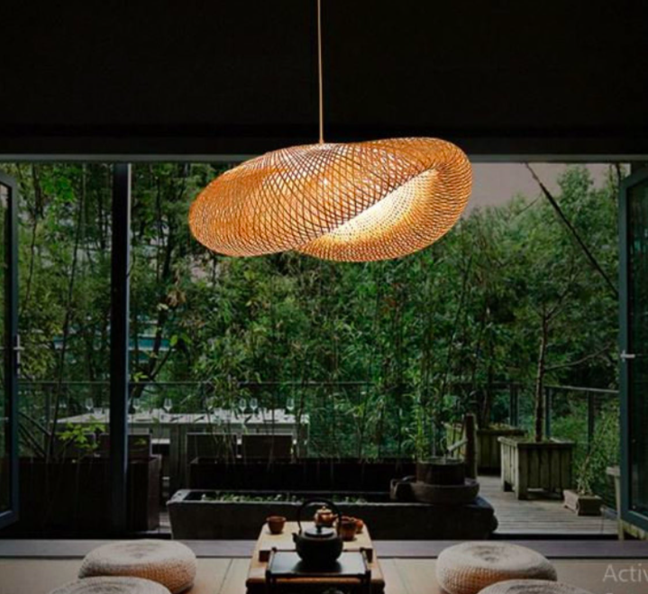 A large hanging rattan lampshade in an enormous living room