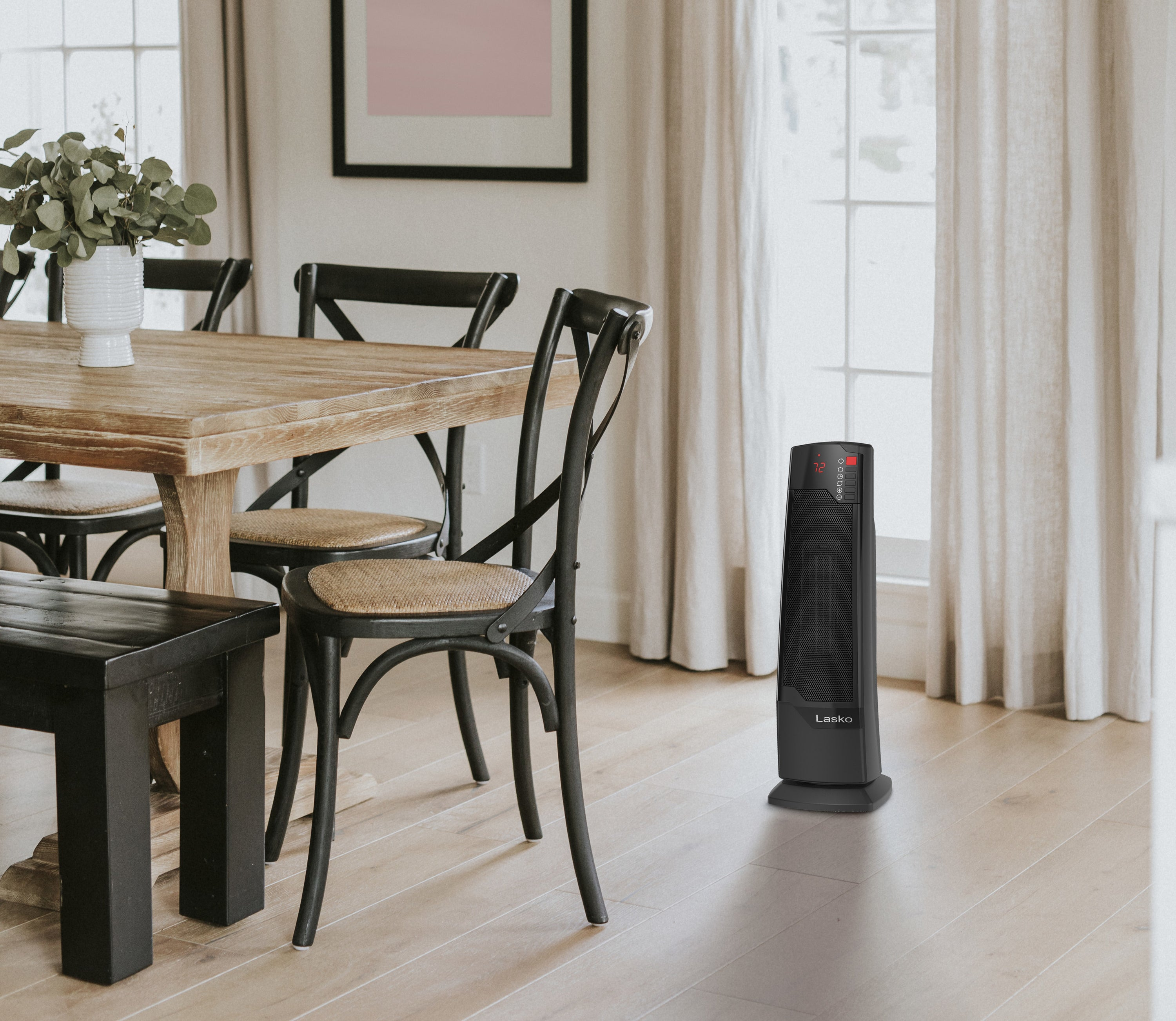 space heater on the floor next to a kitchen table