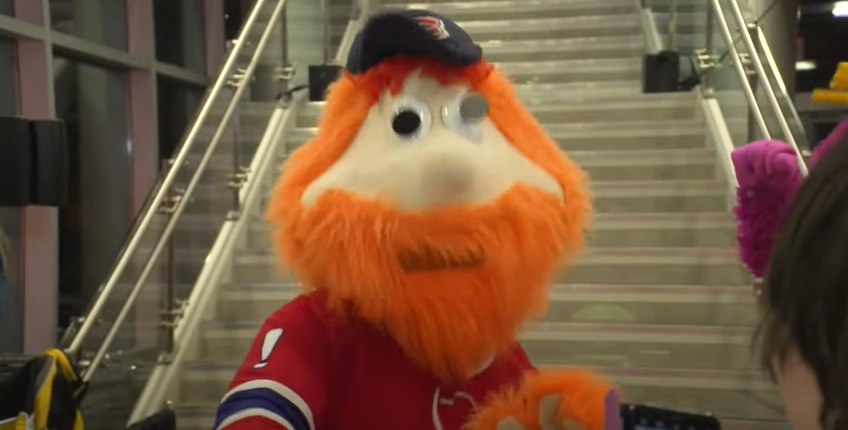 Youppi by a staircase.