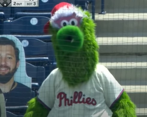 Phillie Phanatic behind a baseball net.