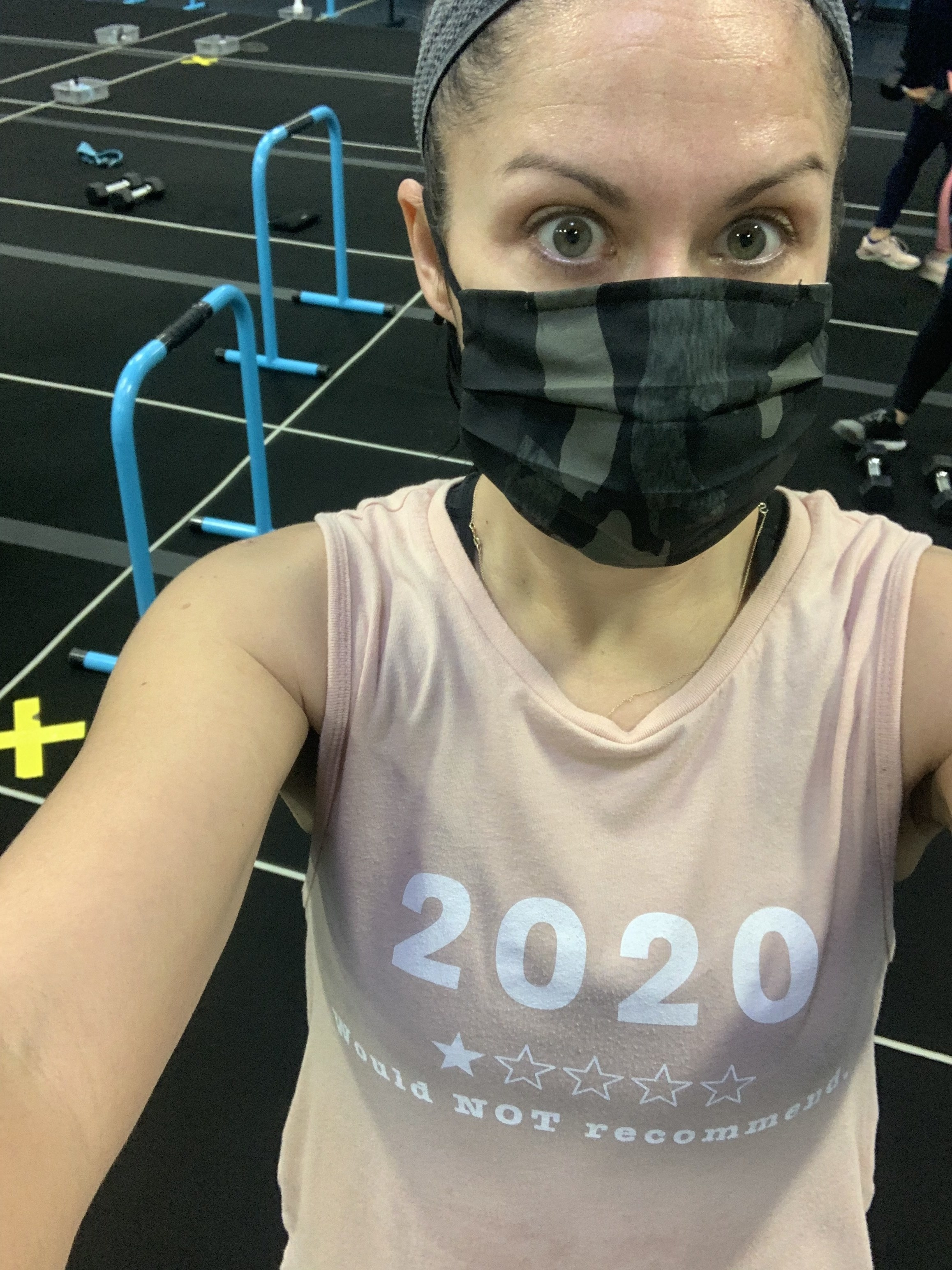 The author in a mask at her local gym