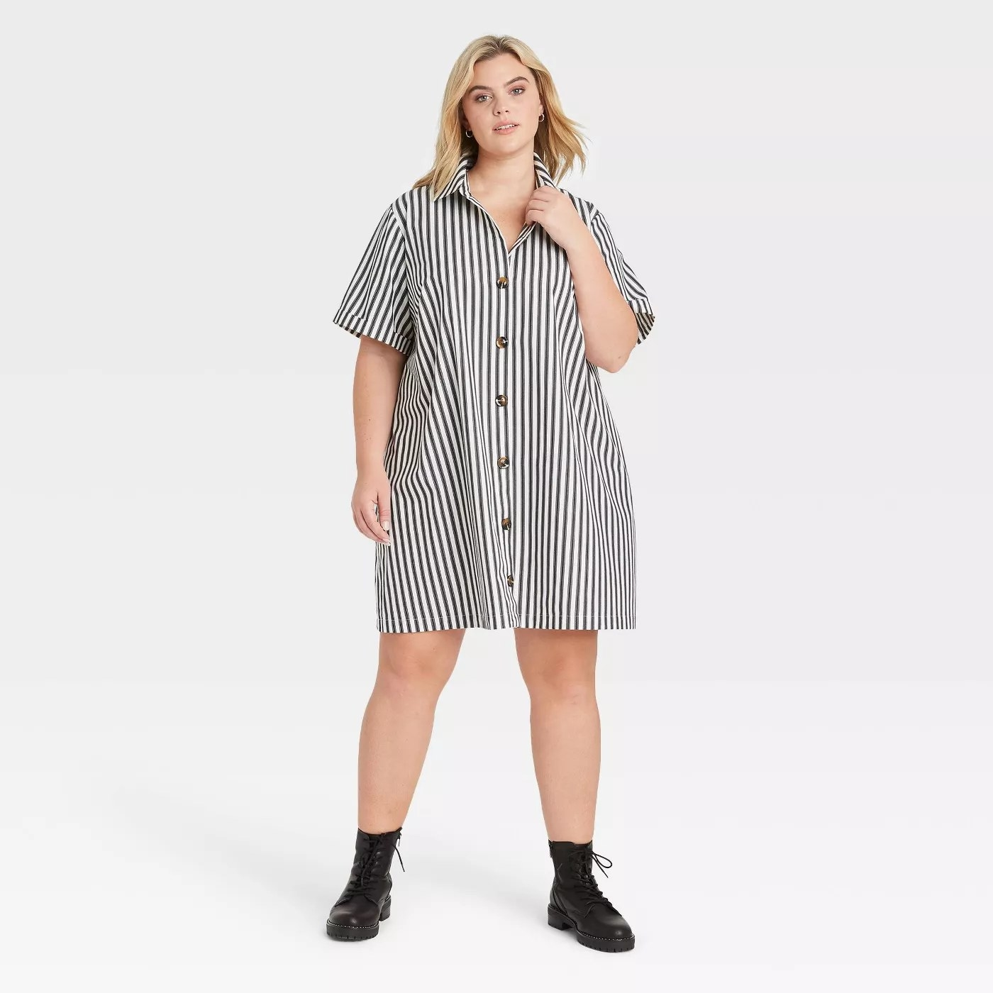 Model in striped dress with buttons down the front