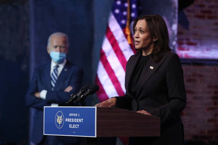 U.S. President-elect Joe Biden listens as Vice President-elect Kamala Harris addresses the media about the Trump Administration's lawsuit to overturn the Affordable Care Act on November 10, 2020 at the Queen Theater in Wilmington, Delaware
