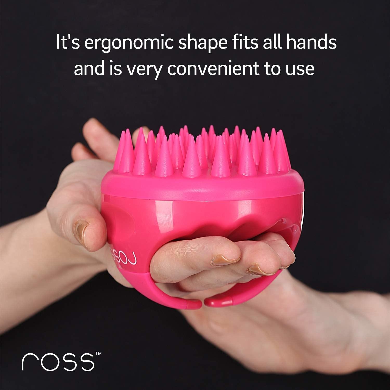 A pink scalp massager