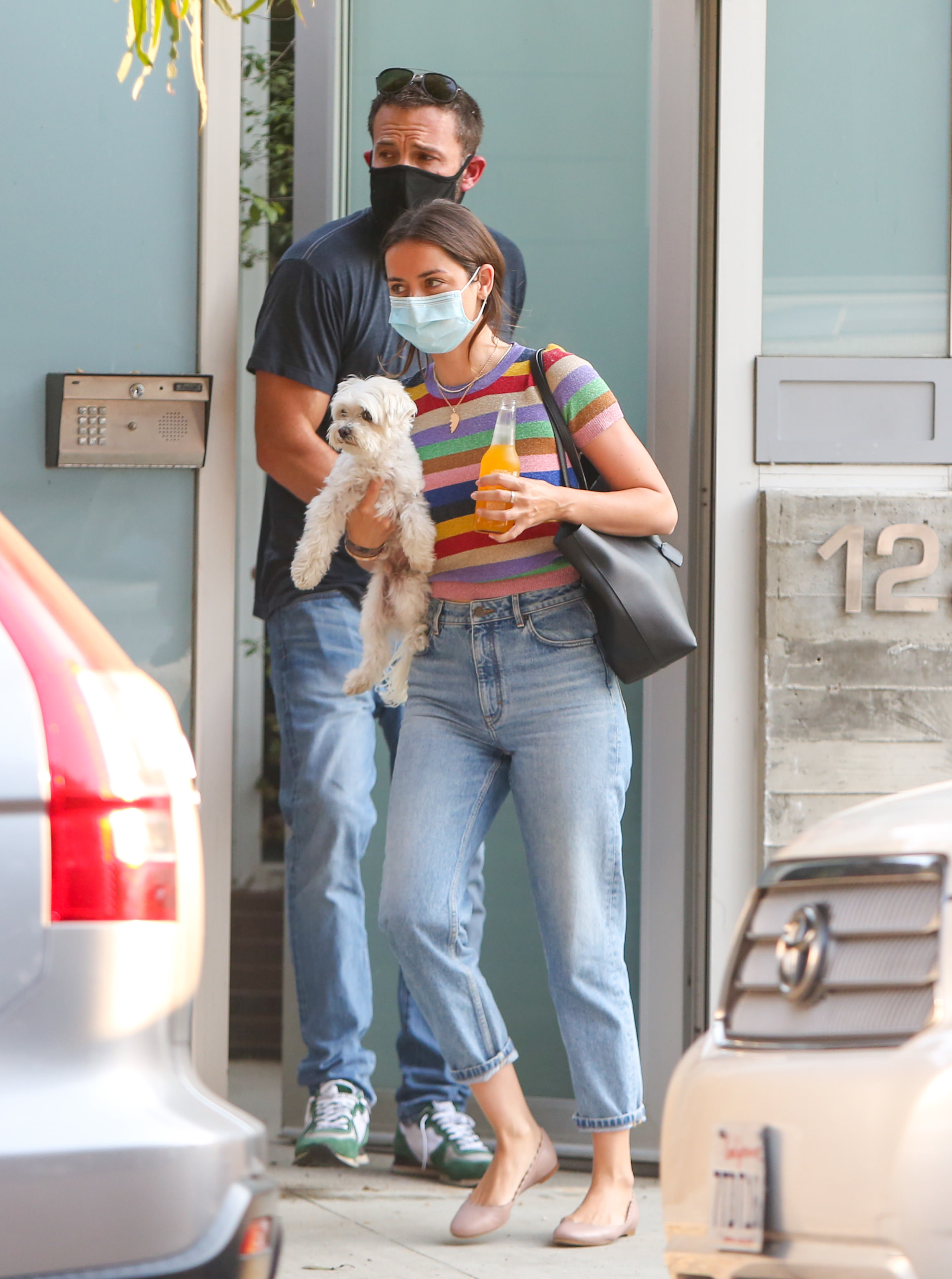 Ben Affleck and Ana de Armas are seen walking out of a building with a dog