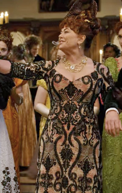 Lady Featherington wears a gown with a dramatic orange and black print