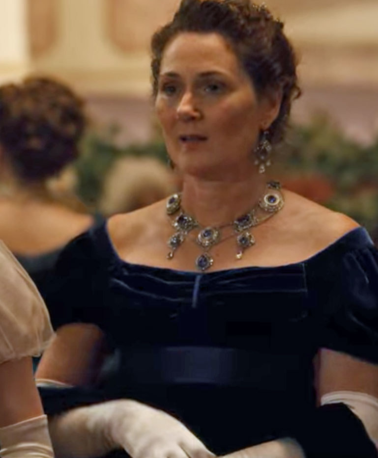 Lady Bridgerton wears a blue velvet gown and matching jewellery