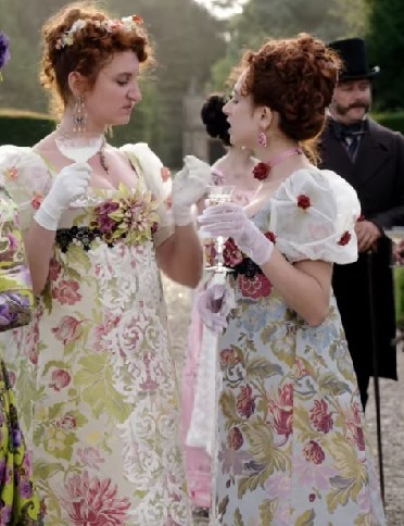 The Featherington sisters wear floral print dresses with lace and flower details