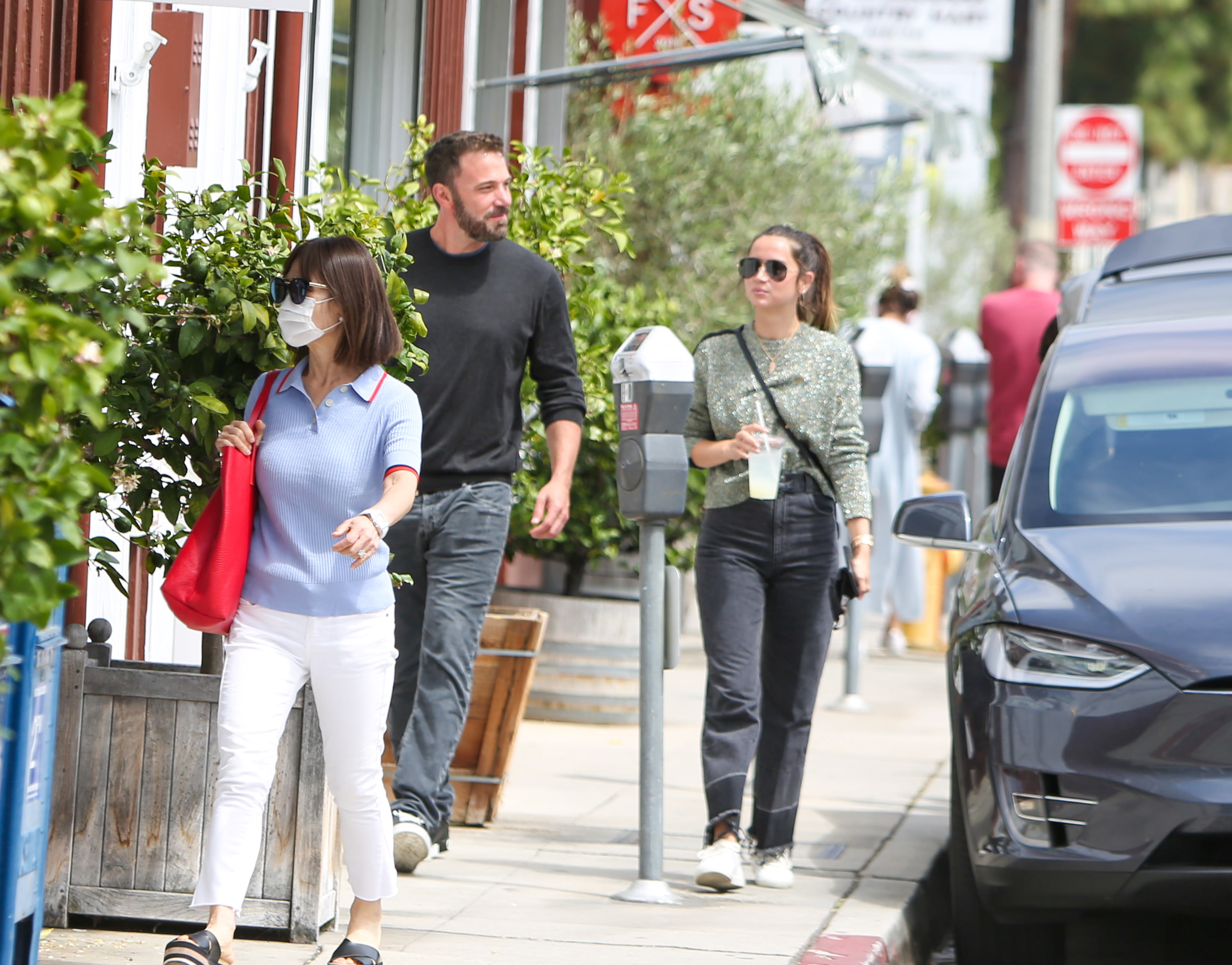 Ana de Armas and Ben Affleck are seen walking and sipping on iced beverages