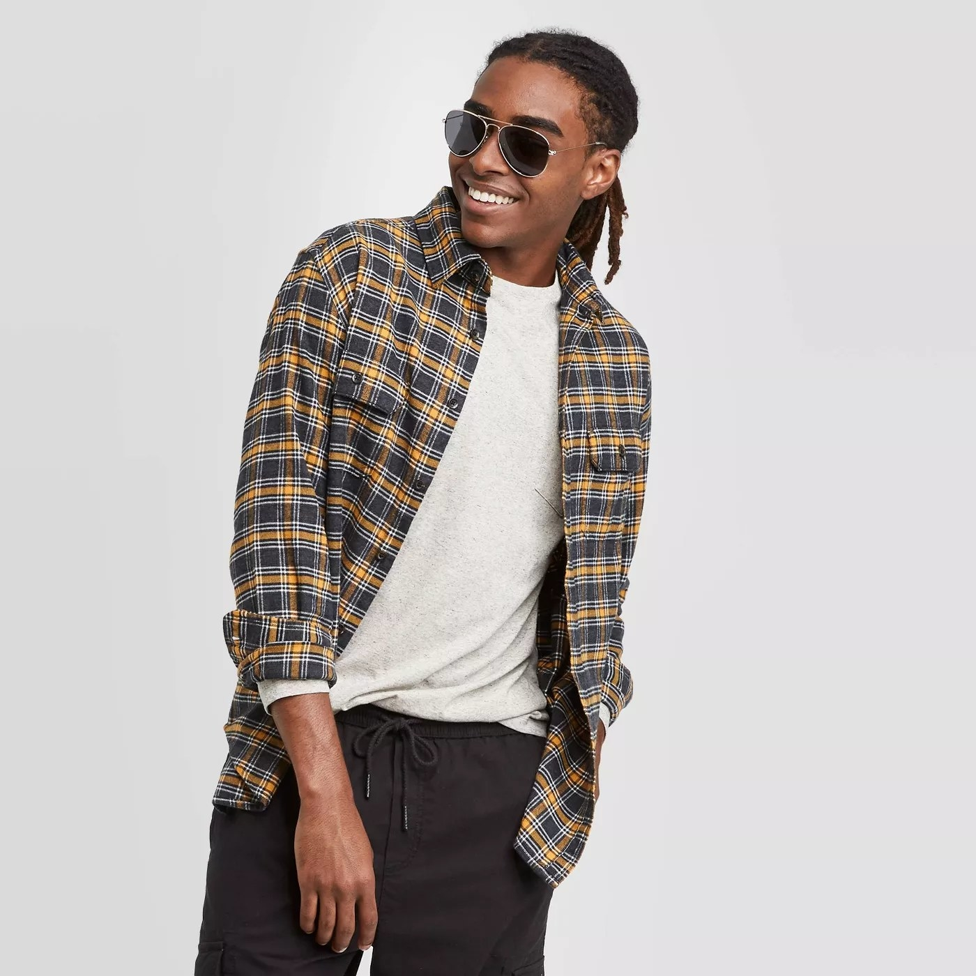 A model wearing the flannel in gold