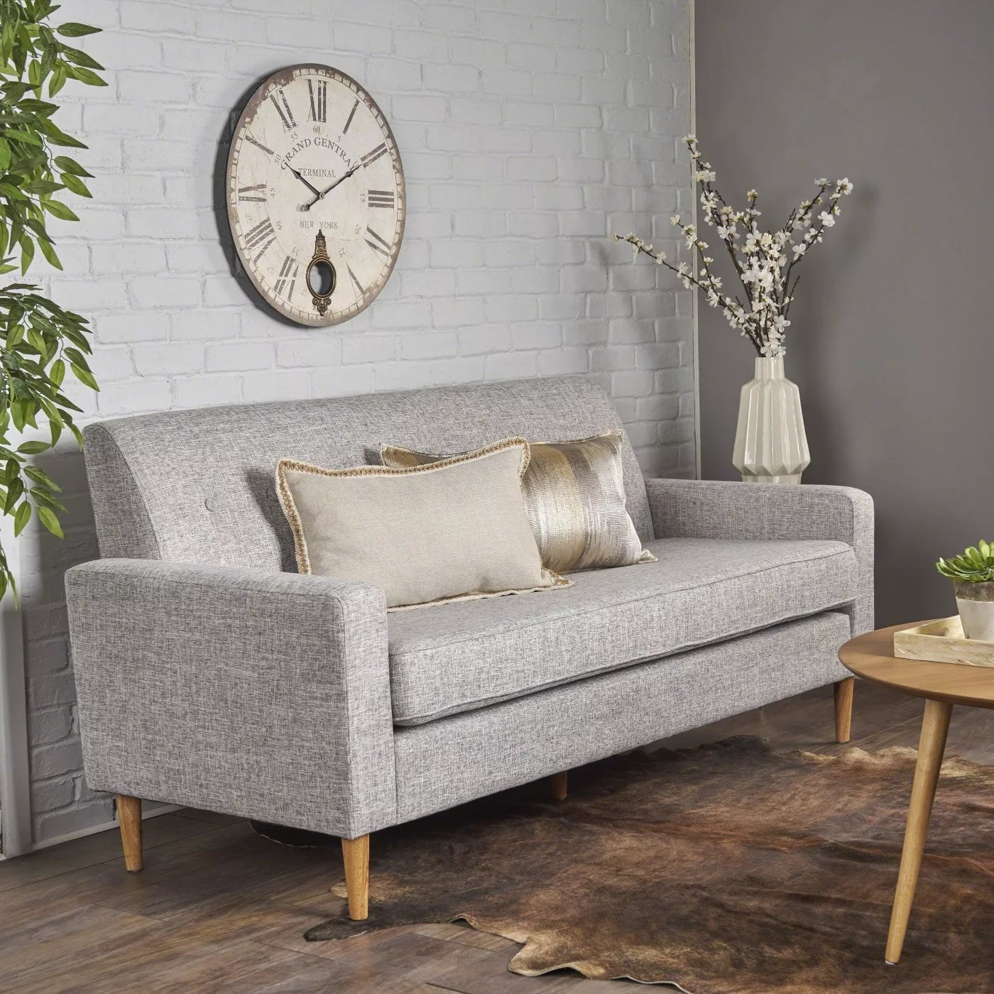 The sofa in light gray tweed