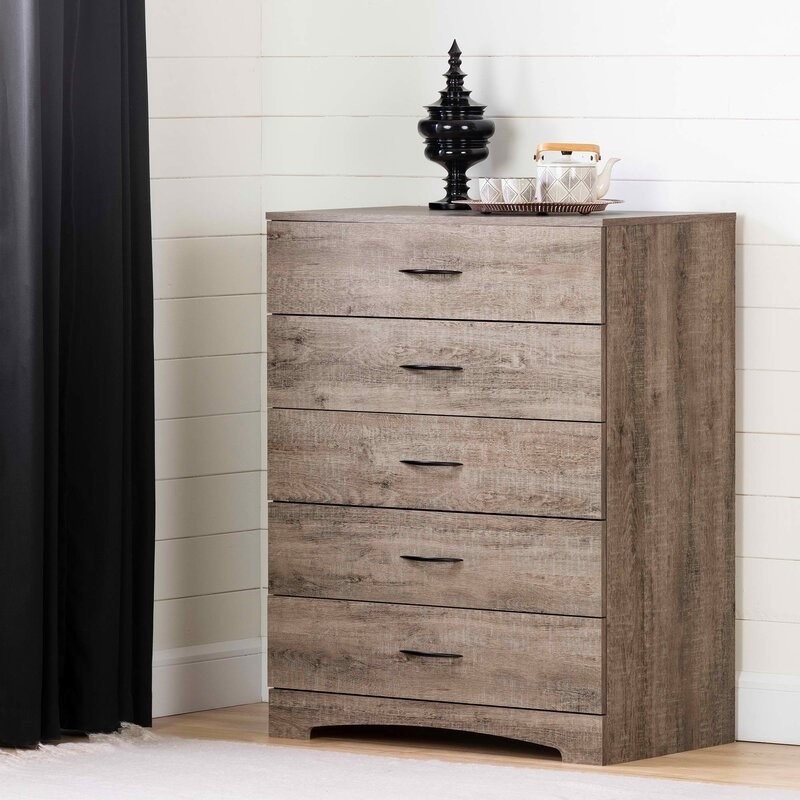 a brown/grey drawer system with five drawers and black metal hardware
