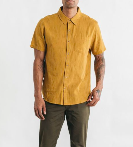 Model in yellow short-sleeve button down