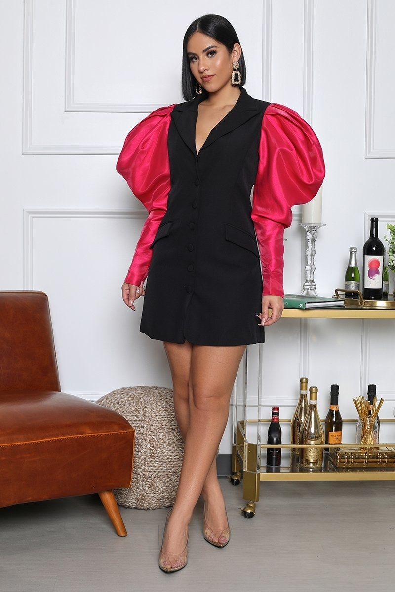 Model in a black blazer minidress with hot pink puff sleeves