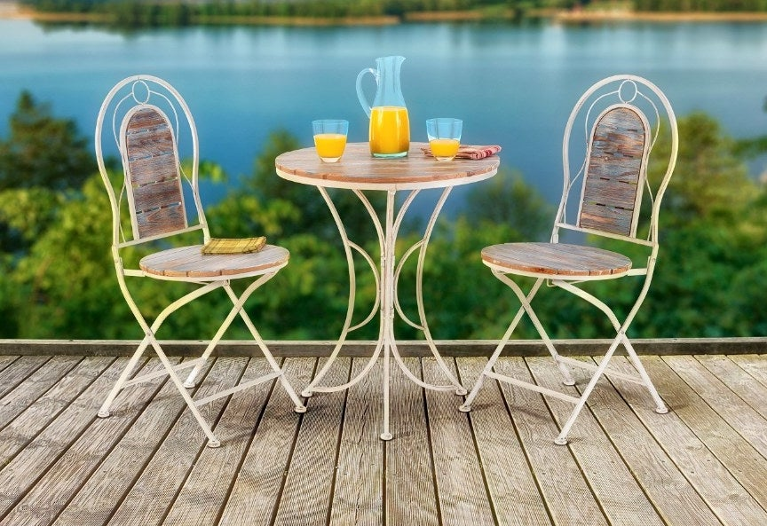 Bistro set with two chairs and table with wooden detail