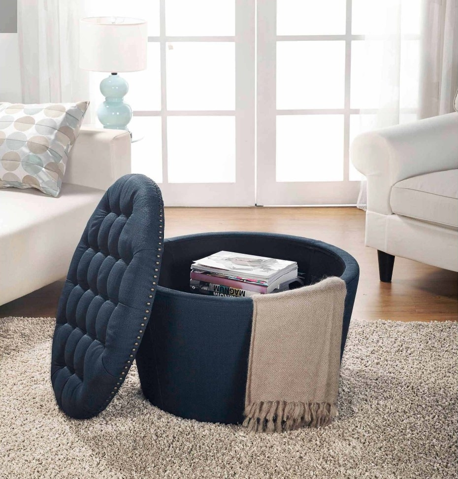 Navy round ottoman with lid off, magazines/blanket inside