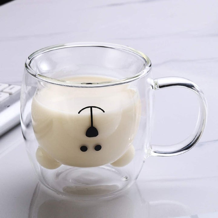 tea cup with upside down bear head inner chamber