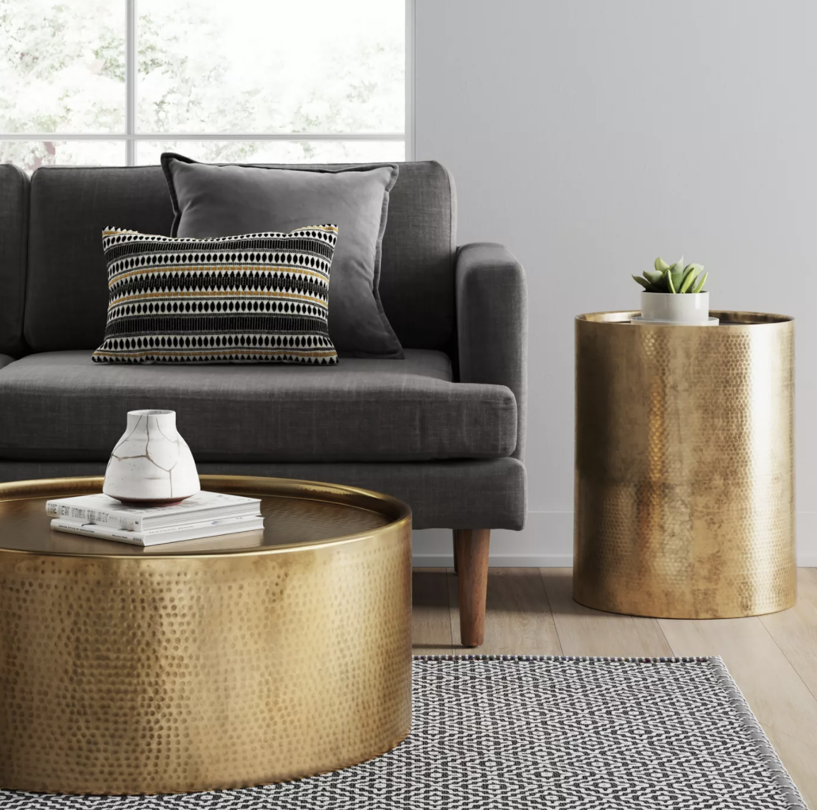 a gold hammered drum-like side table