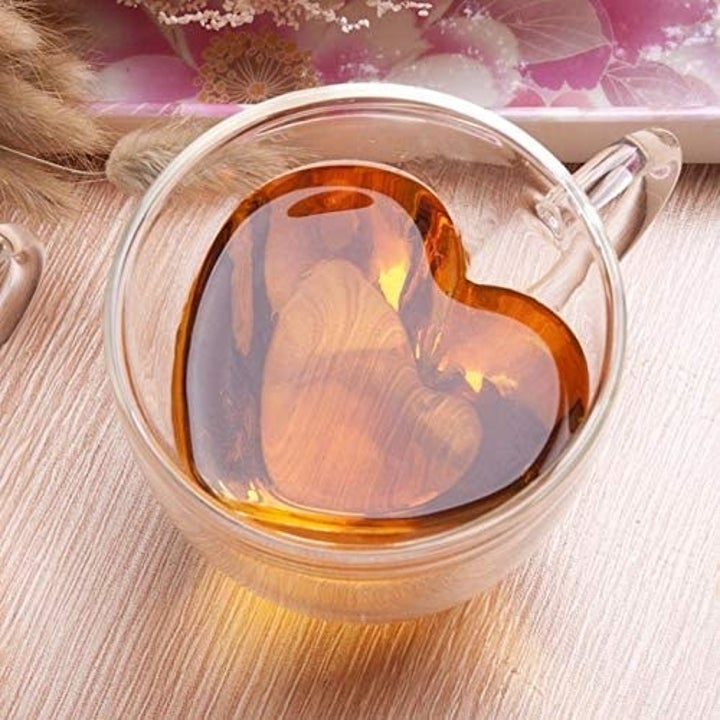 glass teacup with heart shaped inner chamber