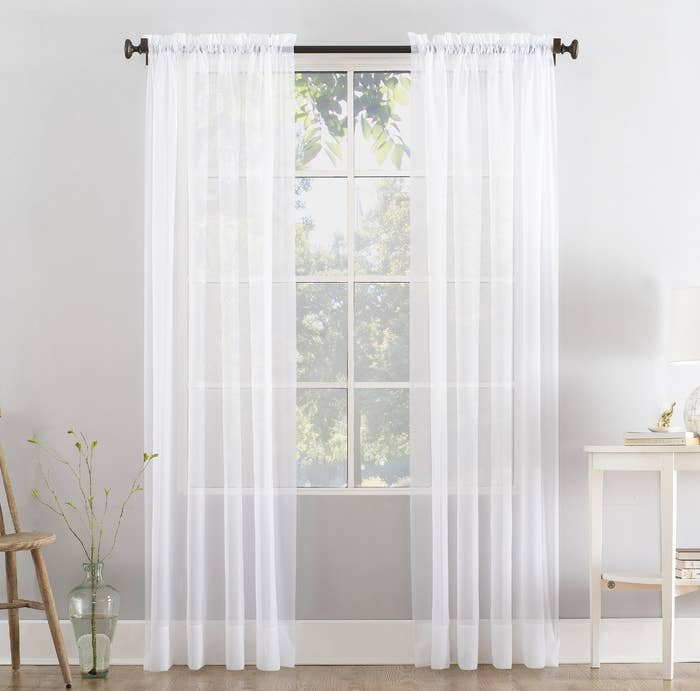 Two white sheer curtain panels