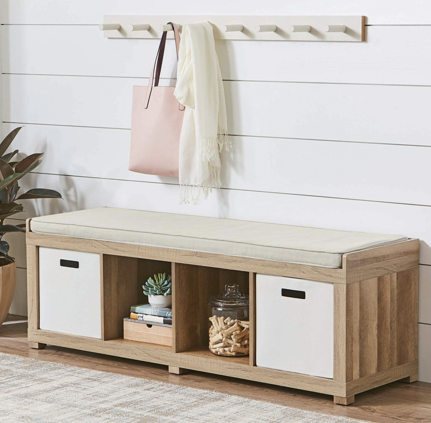 A cream and light wood bench with storage
