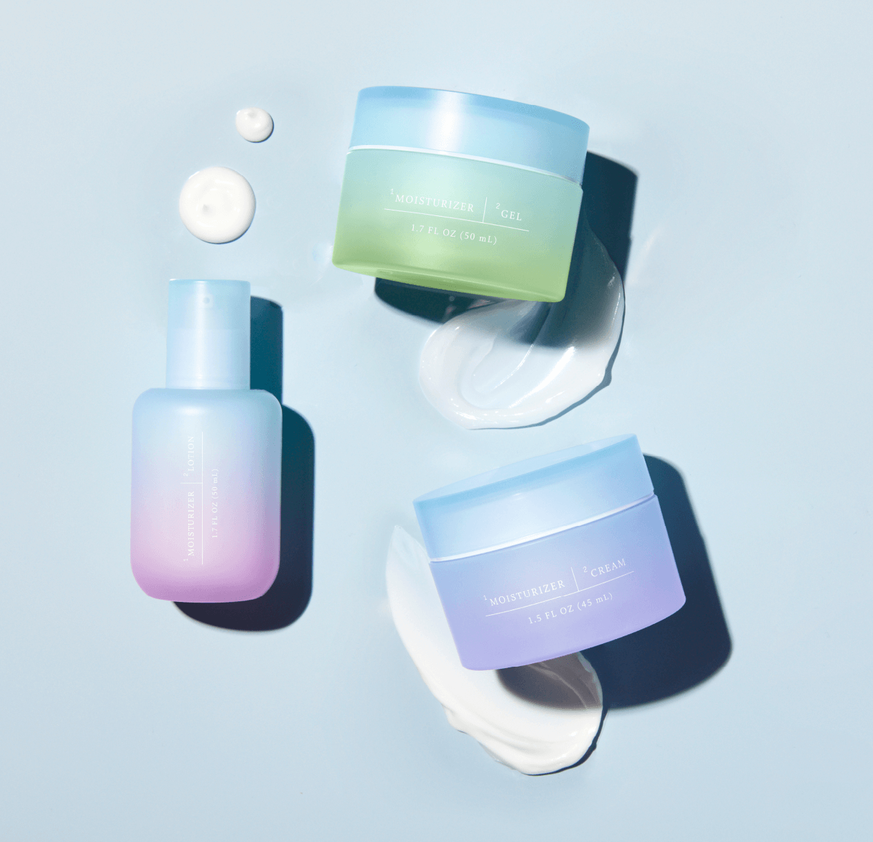 The moisturizing gel, cream, and lotion which come in ombre blue, purple, and green containers