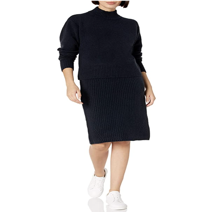 a model in the sweater and skirt in black