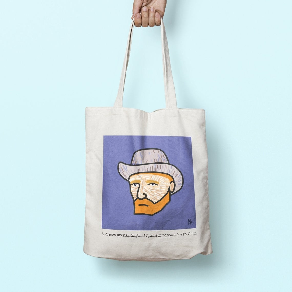 A person holding the tote bag by its handles
