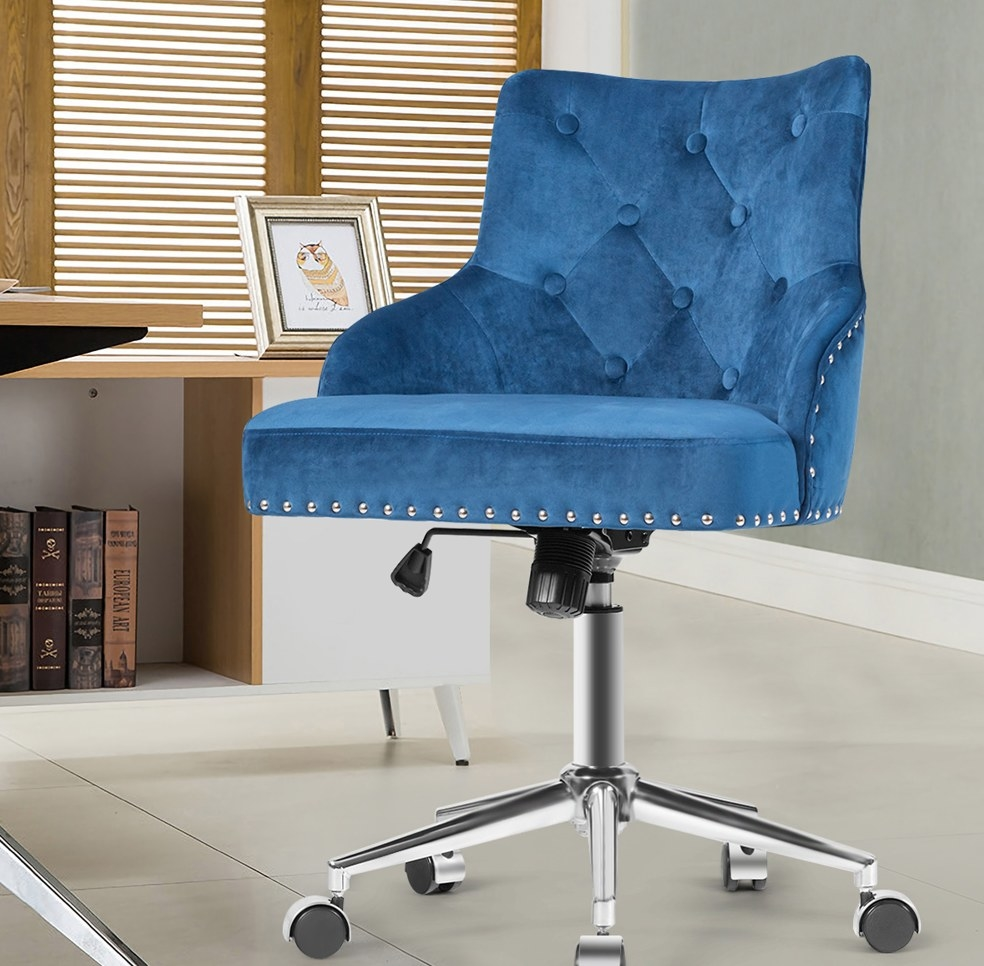 Blue velvet upholstered desk chair with nailhead detailing