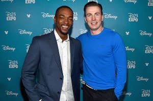 Anthony Mackie and Chris Evans posing together at a red carpet event