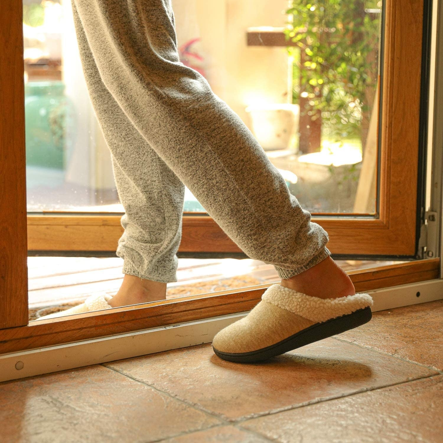 Slide-on slippers with fuzzy interior and thick sole suitable for outdoor use