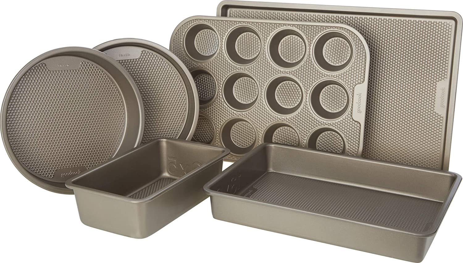 Two round cake pans, a cookie sheet, a muffin tin, a loaf pan, and a rectangular cake pan