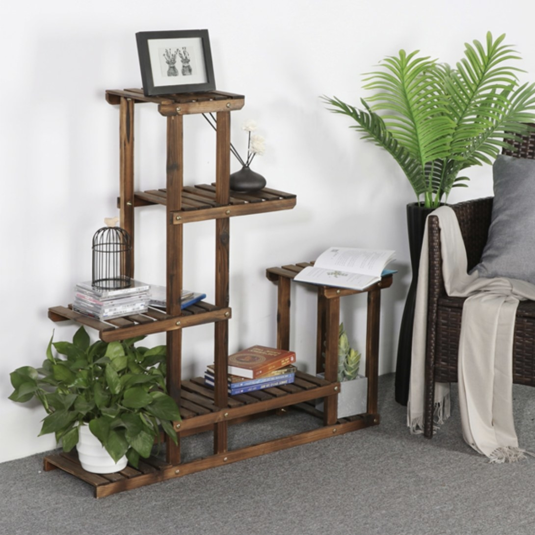 A dark wood plant stand