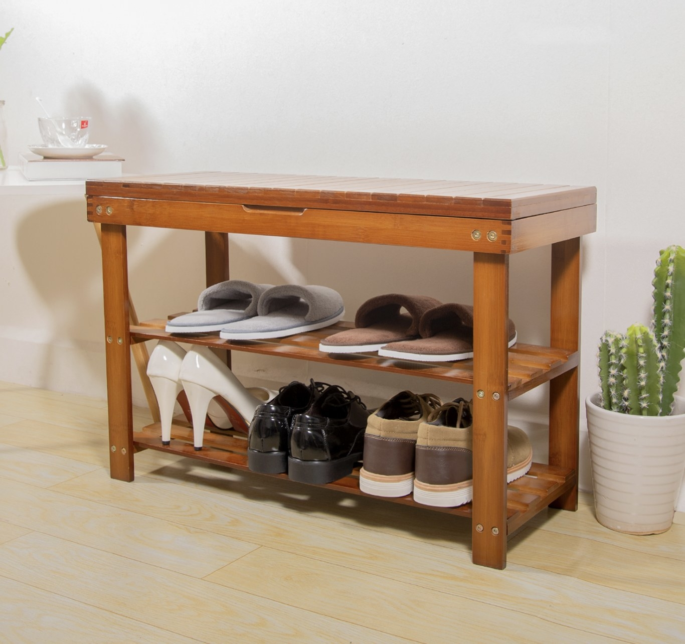 A cherry wood shoe organizer and bench