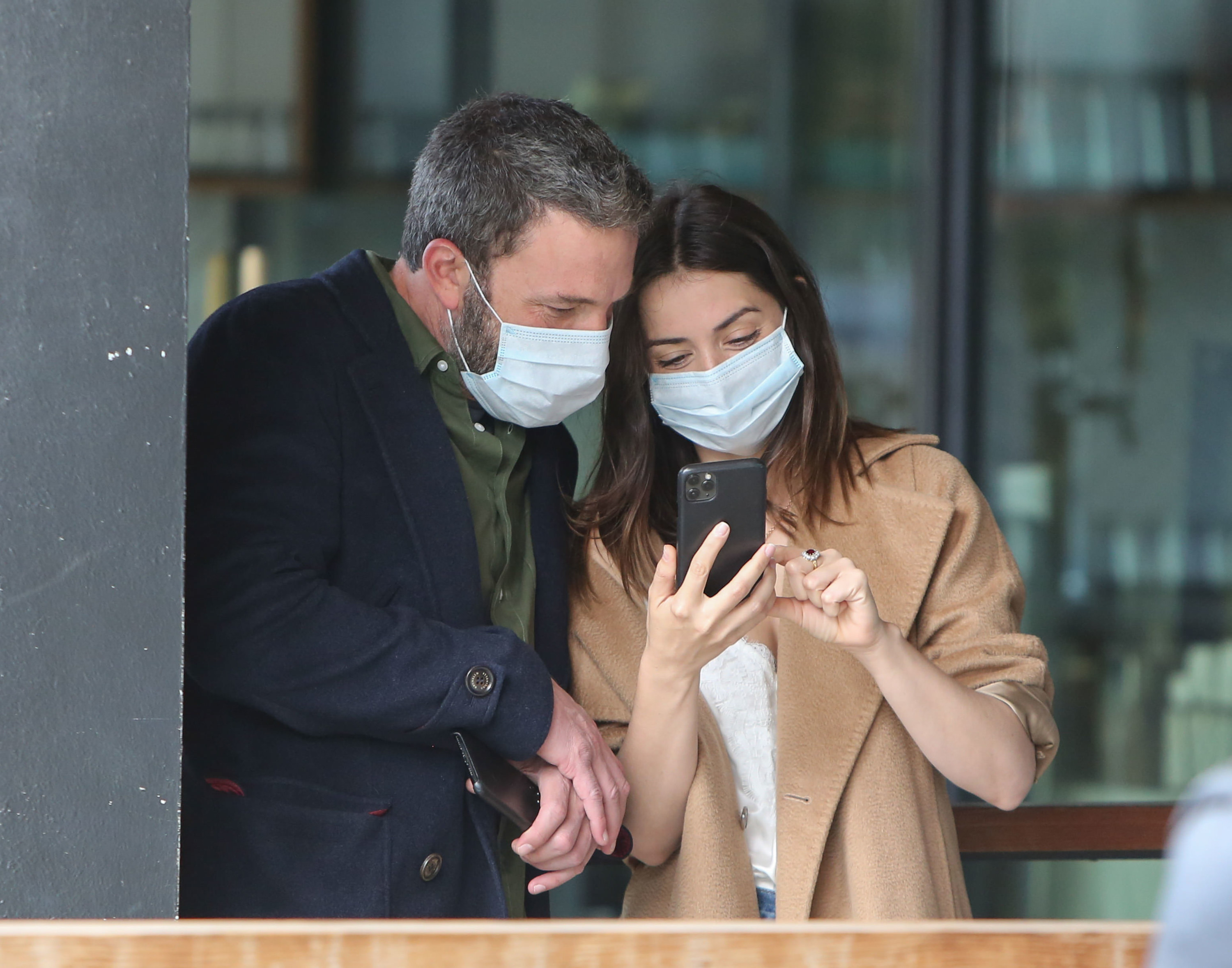 Ben Affleck and Ana de Armas taking pics together while wearing face masks