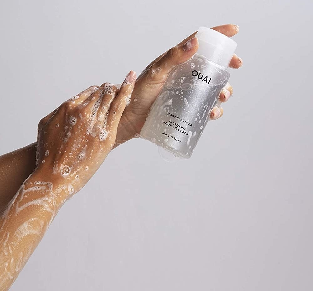 A model applying the sudsy body cleanser