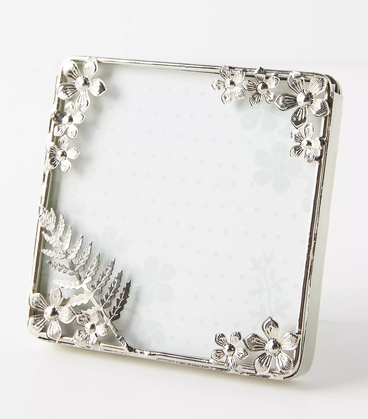 A silver frame with floral decorations