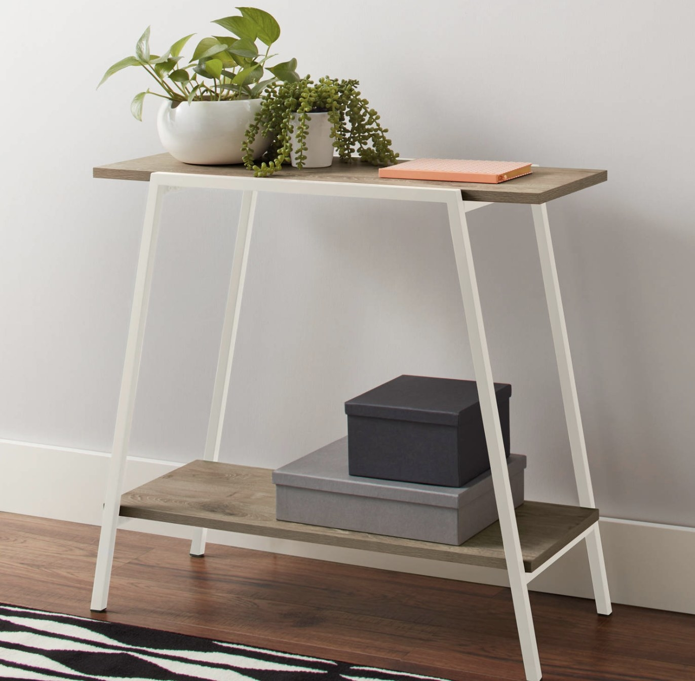 A white and wood console table